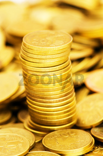 Golden coins stack - shallow depth of field