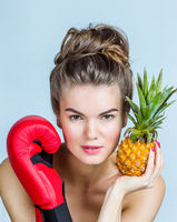 Woman with pineapple and boxing glove
