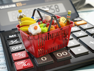 Shopping basket full of grocery foods on calculator. Savings, dieting consumerism concept background.