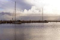 Harbor sunrise with docked sailing ships