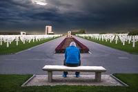 Man contemplating in a memorial cemetery