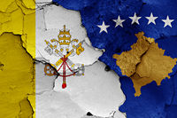 flag of Vatican and Kosovo painted on cracked wall
