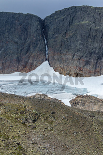 Rock face with a glacier in a wild landscape