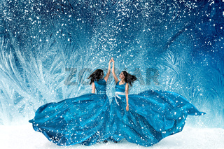 Two beautiful women dancing in fairy tale forest
