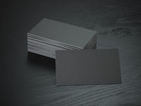 Black blank business cards mockup on black wood table background,