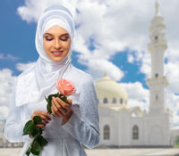 Muslim girl at mosque background
