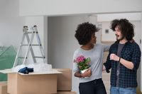 multiethnic couple moving into a new home