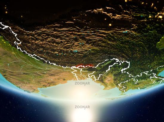 Bhutan with sun on planet Earth