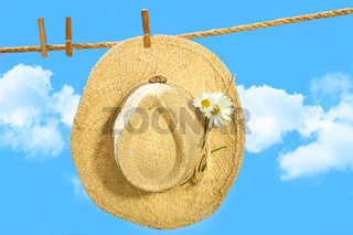 Straw hat on clothesline