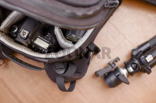 Professional Photography Equipment in Protective Backpack and Tripod
