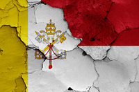 flag of Vatican and Monaco painted on cracked wall
