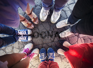 Group of friends with their legs in a complete circle