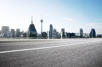 empty asphalt road with modern buildings