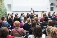 Man giving presentation in lecture hall at university.