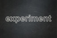 Science concept: Experiment on chalkboard background