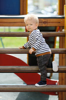 One year old baby boy toddler at playground