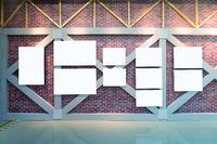 blank frames on brick wall