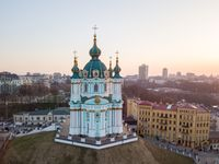 aerial view of Podol and St Andrew's Church on the sunset in Kiev city
