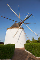 Old traditional windmill on the hill near El Granado in Andalusia, Spain