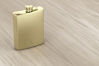 Golden hip flask