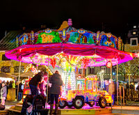Illuminated merry-go-round at a christmas markted