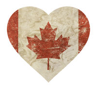 Heart shaped grunge vintage faded flag of Canada