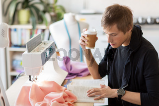 fashion designer with coffee and book at studio