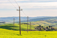 Power line in a field at a rural landscape