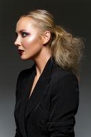 beautiful blond girl with dark makeup