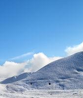 Gondola lift and snowy off-piste ski slope