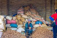 Chinese Market Piles Sacks Potato Salesman
