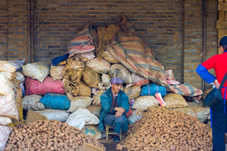 Chinese Market Piles Sacks Potato Salesman