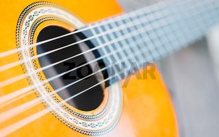 Acoustic guitar bridge and strings close up