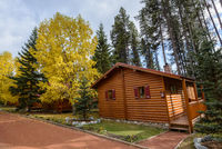 Comfortable quiet wooden hotel at the multicolored fall forest