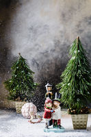 Christmas tree, a ceramic figure, Christmas toys on a gray background with a divorce