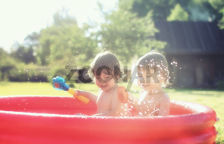 baby splashing in the pool outdoors