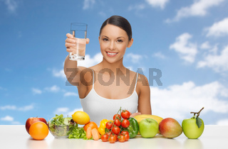 happy woman with glass of water and healthy food
