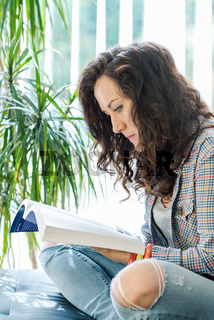 young casual girl reading book