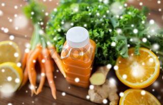 bottle with carrot juice, fruits and vegetables