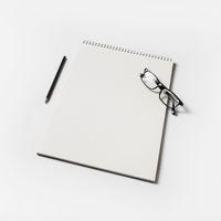 Album, glasses, pencil