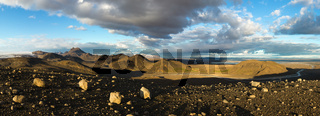 Illuminated panoramic landscape with mountains, glacier and lake in Iceland. Beautiful midnight sun scenery.