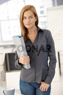 Young office worker woman with folder