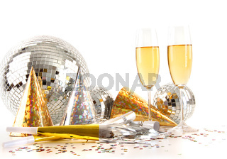 Champagne glasses and disco ball