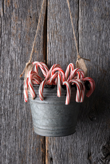 Candy Cane Bucket Hanging on Wood Wall