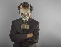 Businessman with gas mask, concept business dangerous for the environment or for society