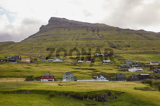 Village in wild and beautiful landscape of Faroe Islands, Denmark