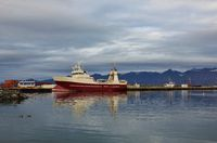 Ship in Dalvik and mountain range.