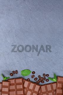 Schokolade Milchschokolade Tafel Schiefertafel Essen hochkant Textfreiraum von oben