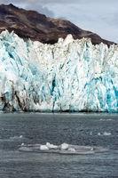 Ice Chunks Dwarfed by Mountains Aialik Glacier Alaska Kenia Fjords