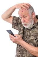 senior man confused with something at mobile smartphone, isolated on white